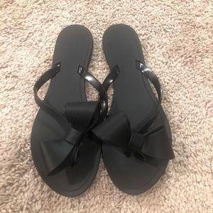 Black Plastic Bow Sandals Flip Flops Sz 37 NWOT